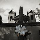 Kneeling at the Cross, Santuario de Chimayo by Mitchell Tillison