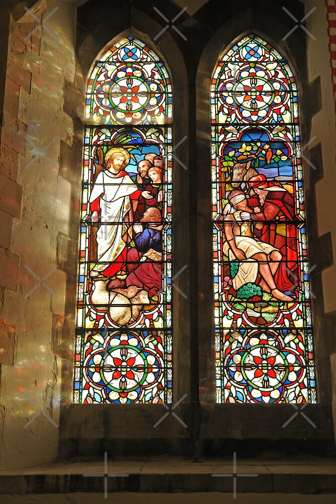 Light filtering through a set of stained glass windows at St. Mary Church in Dover Castle by ashishagarwal74