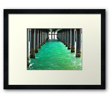 Peering Beneath the Pier Framed Print