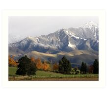 Mountain Ridge Against A Snow Laden Sky Art Print