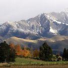 Mountain Ridge Against A Snow Laden Sky by coffeebean