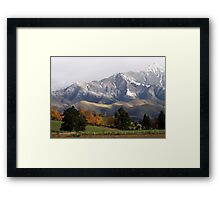 Mountain Ridge Against A Snow Laden Sky Framed Print