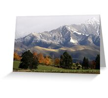 Mountain Ridge Against A Snow Laden Sky Greeting Card