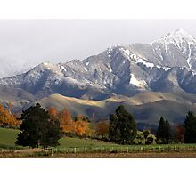Mountain Ridge Against A Snow Laden Sky Photographic Print