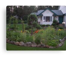 This is the garden and house that you want to come home too... Canvas Print