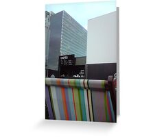 rooftop cinema, deckchair, screen, building, crepebar in daylight Greeting Card