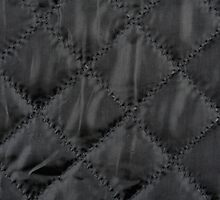 Black quilted cloth texture abstract by Arletta Cwalina
