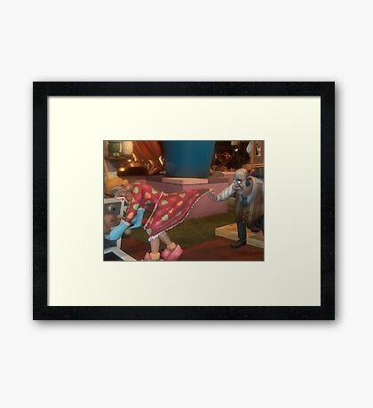 She checking on dinner and he on what's for dessert maybe...... Framed Print