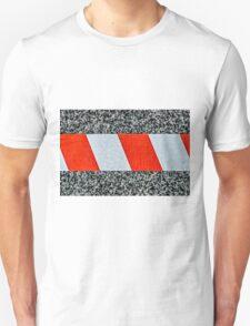 Red warning tape across granite stone T-Shirt
