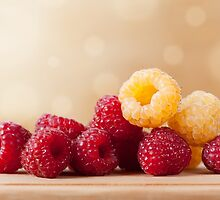 red and golden raspberry fruits by Arletta Cwalina