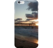 Sunrise through pier at beach iPhone Case/Skin