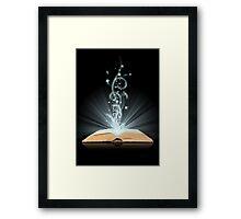 Open book magic on black Framed Print