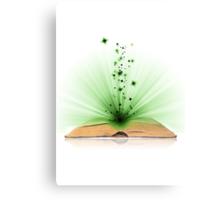 Open book magic on white Canvas Print