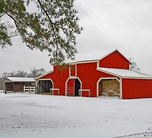 red barn in the snow by Wanda Faircloth