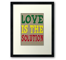 LOVE IS THE SOLUTION Framed Print