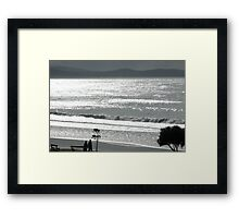 Silvery sea shimmering Framed Print