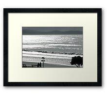 Silvery sea shimmering Framed Print