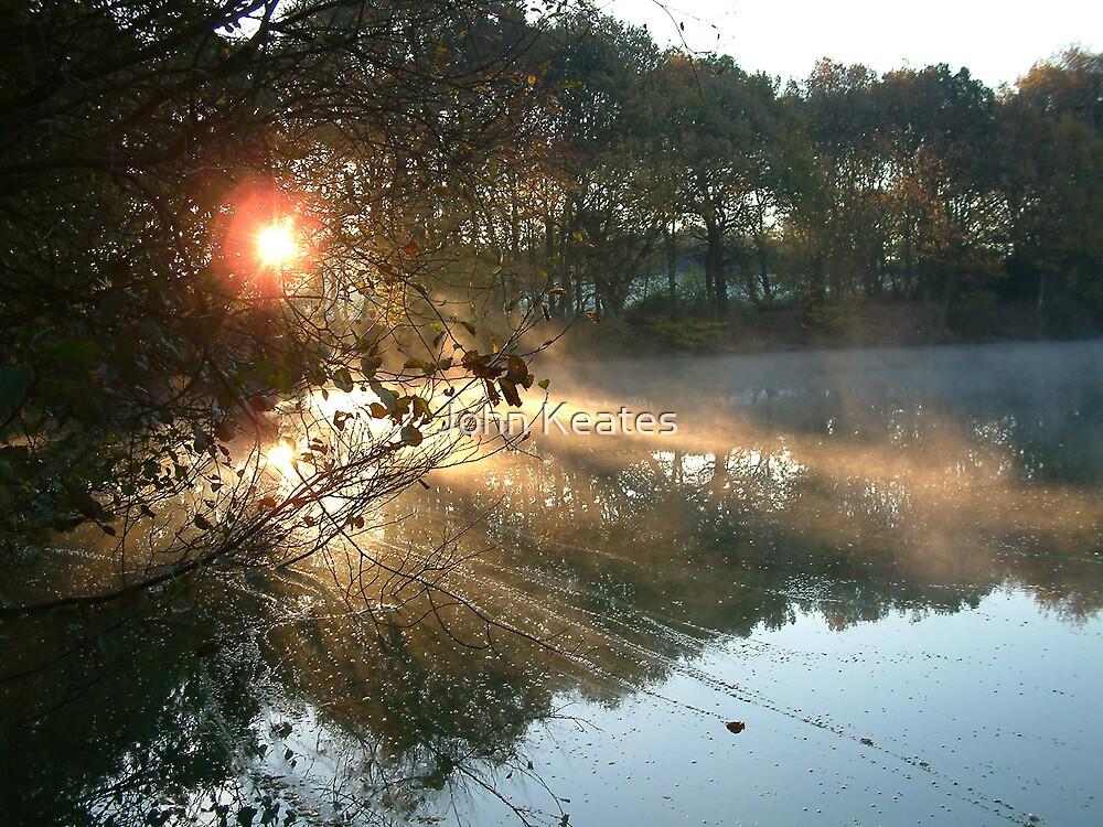 Sunrise over pool by John Keates