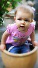 Little Girl in a Flower Pot by Evita