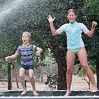 Under The Sprinkler by Jenny Brice