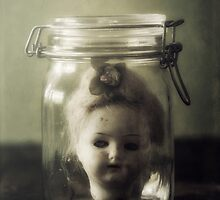 doll in jar by Joana Kruse