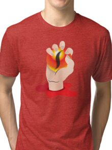 Hand grasping an orb with a tigers eye Tri-blend T-Shirt