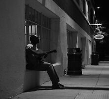 Guitarist Outside a Coffee Shop  by Brian Humek
