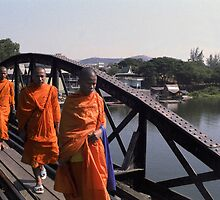 Buddhist Monks on Bridge Over River Kwai by Bev Pascoe