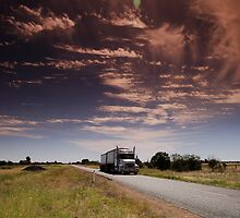 truck on remote road hot day by Danny  Waters