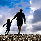 MAN AND CHILD HEADING FOR THE BEACH by kfbphoto