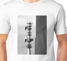 Communications tower bristling with antennas and aerials with contrasting walls and moody sky Unisex T-Shirt