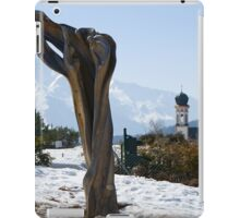 Sculpture and Tyrolean church in the background iPad Case/Skin