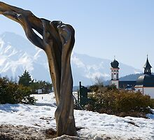 Sculpture and Tyrolean church in the background by Elzbieta Fazel