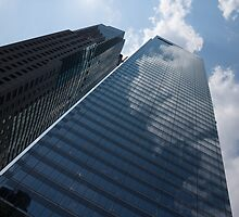 Sky and Sky - Toronto Skyscraper Reflecting Fluffy White Clouds by Georgia Mizuleva