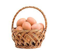eggs in wicker basket  by Arletta Cwalina