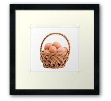 eggs in wicker basket  Framed Print