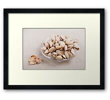 pistachio nuts in shell lying Framed Print