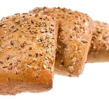 Fresh baked graham bread rolls by Arletta Cwalina