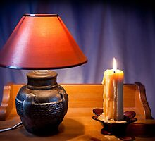 night light lamp and burning candle by Arletta Cwalina
