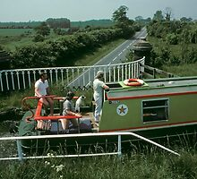 Narrow boat crossing Stretton Aqueduct, UK. by David A. L. Davies