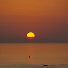 Orange Sunset over Ocean by Rebecca Silverman