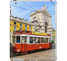 Old red tram at  triumphal arch on the Palace Square in Lisbon iPad Case/Skin