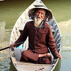 Boat man in Vietnam by tracyleephoto