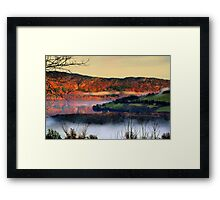 The clouds that snake across the lake Framed Print