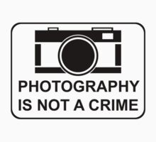 PHOTOGRAPHY IS NOT A CRIME by strayfoto