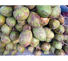 A number of tender raw coconuts in a pile Photographic Print
