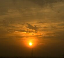 A very bright sunset over some electric pillars by ashishagarwal74