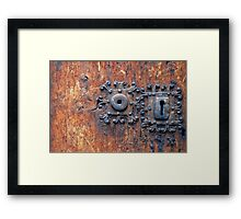 Old door with 3 keyholes Framed Print