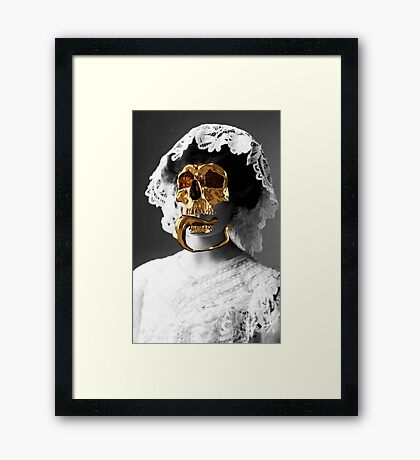 Golden skull Framed Print