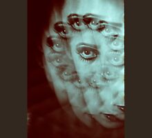 Multiple image of eye of young woman with makeup in dark analog film 35mm photo Unisex T-Shirt
